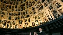 Canadian Foreign Minister Peter MacKay (R) looks at pictures of Jews killed during the Holocaust, during a visit to the Hall of Names at the Yad Vashem Holocaust Memorial in Jerusalem January 21, 2007. (Oleg Popov/Reuters/Oleg Popov/Reuters)