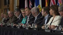 Canada's premiers are seen during the closing news conference following a meeting of premiers in Whitehorse, Yukon, on July, 22, 2016. (JONATHAN HAYWARD/THE CANADIAN PRESS)