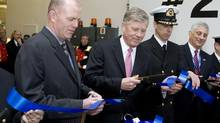 BC Ferries CEO and president Mike Corrigan, left, participates in a ribbon-cutting ceremony with his predecessor, David Hahn, in 2008. (Arnold Lim for The Globe and Mail)