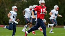 The New England Patriots warm up for this weekend's Super Bowl. Bettors will wager about $150-million on sports this weekend through offshore websites and illegal bookmakers. (GETTY IMAGES)