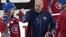 Montreal Canadiens head coach Michel Therrien goes over a play with David Desharnais, left, and Max Pacioretty, right, during a team practice. (Ryan Remiorz/The Canadian Press)