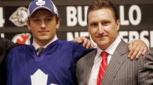 Jiri Tlusty, left, poses for a photo with former Toronto Maple Leafs general manager John Ferguson at the 2006 NHL Entry Draft in Vancouver. (CHUCK STOODY)