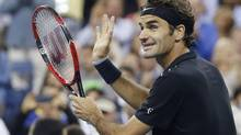 Roger Federer celebrates defeating Sam Groth of Australia in their men's singles match at the 2014 U.S. Open (SHANNON STAPLETON/REUTERS)