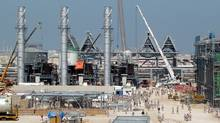 A gas-to-liquids plant that is co-owned by South Africa's Sasol is shown here under construction in Qatar (STR/Associated Press)