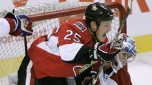 The Ottawa Senators' Chris Neal (L) knocks the Montreal Canadiens' goaltender Carey Price after scoring during the first period of their pre-season NHL hockey game at Scotiabank Place in Ottawa, September 25, 2010. REUTERS/Patrick Doyle (PATRICK DOYLE)