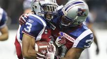 Montreal Alouettes running back Dahrran Diedrick (right) congratulates wide receiver Tim Maypray (Ryan Remiorz/The Canadian Press)