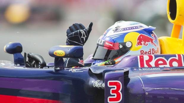 Red Bull driver Daniel Ricciardo from Australia waves to fans after winning the Canadian Grand Prix in Montreal, Sunday June 8, 2014. (Graham Hughes/THE CANADIAN PRESS)