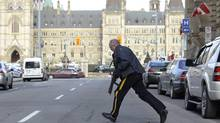 Police secure an area around Parliament Hill in Ottawa on Wednesday Oct.22, 2014. A gunman opened fire at the National War Memorial, wounding a soldier, then moved to nearby Parliament Hill and wounded a security guard before he was shot, reportedly by Parliament's sergeant-at-arms. (The Canadian Press)