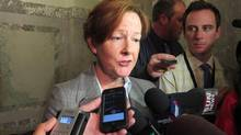 Former Alberta premier Alison Redford returned to work as the backbench MLA for the riding of Calgary-Elbow at the legislature in Edmonton on Monday, May 5, 2014. Redford had not been in the legislature since she resigned March 23. (Dean Bennett/THE CANADIAN PRESS)