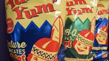 Vintage bags of Yum Yum potato chips featuring their little aboriginal logo are pictured Friday, November 15, 2013 in Montreal. The company is offering them over the holiday season again after changing the packaging during the 1990 Oka native crisis. (Ryan Remiorz/THE CANADIAN PRESS)
