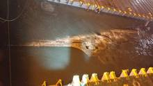 In this handout photo released by the South Korean Maritime Ministry, a submersible vessel attempts to salvage sunken Sewol ferry in waters off Jindo, on March 22, 2017 in Jindo-gun, South Korea. (Handout/South Korean Maritime Ministry v)