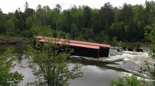 In this OPP handout photo from CTV, a train car is seen in a river after a bridge collapse caused a Canadian Pacific train to derail. (Frank Elsner/Ontario Provincial Police via CTV)