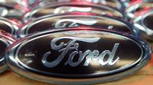 Ford logos are seen at the assembly line of the Ford car factory of Saarlouis, December 6, 2010. (VINCENT KESSLER/VINCENT KESSLER/REUTERS)
