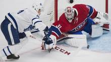 Montreal Canadiens goaltender Carey Price makes a save against Toronto Maple Leafs' Leo Komarov during second period NHL hockey action in Montreal, Saturday, November 19, 2016. (Graham Hughes/THE CANADIAN PRESS)