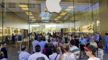 In this Wednesday, Oct. 19, 2011, file photo, a line of customers enter an Apple store in Scottsdale, Ariz. (Matt York/AP)
