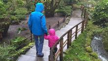 A two-year-old Metis girl walks with her foster father in Butchart Gardens in Victoria, B.C. in January, 2016. (THE CANADIAN PRESS)