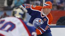 "In this Oct. 22, 2016, file photo, former Edmonton Oiler Wayne Gretzky (99) looks for the open player against the Winnipeg Jets Alumni during the third period of an NHL Heritage Classic Alumni hockey game in Winnipeg. NHL.com reported on Nov. 17, 2016, that Gretzky will appear on an episode of ""The Simpsons"" set to air Dec. 11. (John Woods/AP)"