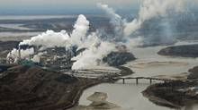Aerial view of the Suncor oil sands extraction facility on the banks of the Athabasca River near Fort McMurray, Alta. (MARK RALSTON/AFP/Getty Images)