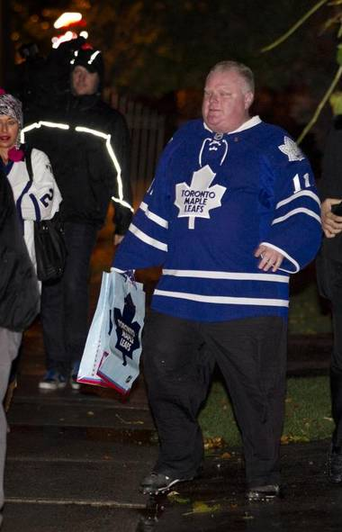 Mayor Rob Ford wears a Leafs jersey while out in the rain for Halloween with his children in Toronto on Oct. 31, 2013. (PETER POWER/THE GLOBE AND MAIL)