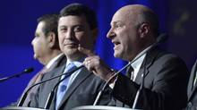 Kevin O'Leary speaks as Michael Chong looks on, during a Conservative Party leadership debate at the Manning Centre conference, on Friday, Feb. 24, 2017 in Ottawa. (Justin Tang/THE CANADIAN PRESS)