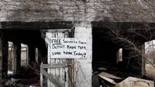 A lone vacant burned-out house filled with garbage with a sign on the door, sits in an area that used to be filled with houses in Detroit's east end. (Deborah Baic/The Globe and Mail) (Deborah Baic/The Globe and Mail)