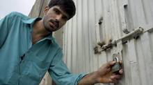 Mukhtar Khan, neighbor of an arrested Christian girl, shows the locked house of a girl and vowed will never allow them to live in this neighborhood, in a suburb of Islamabad, Pakistan on Monday, Aug. 20, 2012. (B.K. Bangash/AP)