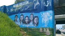A mural on Portage Avenue in Winnipeg shows the faces of missing and murdered aboriginal women, as created by artist Tom Andrich. (Credit: CHRISD.CA) (CHRISD.CA)