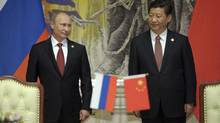 Russia's President Vladimir Putin (L) and China's President Xi Jinping attend a signing ceremony in Shanghai May 21, 2014. Russia's state-controlled Gazprom signed a long-awaited gas supply agreement with China on Wednesday. (RIA Novosti/REUTERS)