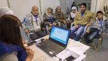A family of Syrian refugees are being interviewed by authorities in hope of being approved for passage to Canada at a refugee processing centre in Amman, Jordan, on Nov. 29, 2015. (Paul Chiasson/THE CANADIAN PRESS)
