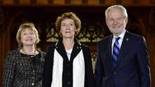 New Senator Renee Dupuis, centre, stands with Senator Diane Bellemare and Senator Peter Harder before being sworn in during a ceremony in the Senate on Parliament Hill, Wednesday, Nov. 16, 2016 in Ottawa. (Justin Tang/THE CANADIAN PRESS)
