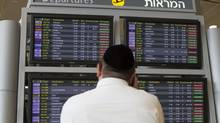 A departure flight board displays various cancelled and delayed flights in Ben Gurion International airport in Tel Aviv on July 23, 2014. (DAN BALILTY/ASSOCIATED PRESS)