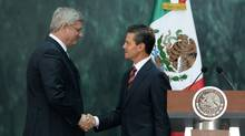 Prime Minister Stephen Harper is greeted by Mexican President Enrique Pena Nieto as he arrives at the National Palace in Mexico City, Mexico on Tuesday, Feb.18, 2014. (SEAN KILPATRICK/THE CANADIAN PRESS)