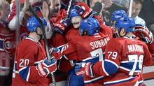 Montreal Canadiens left wing Max Pacioretty (67) is mobbed by teammates after scoring the winning goal against the Tampa Bay Lightning during third period National Hockey League Stanley Cup playoff action on Tuesday, April 22, 2014 in Montreal. (RYAN REMIORZ/THE CANADIAN PRESS)