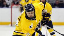 Merrimack forward Stephane Da Costa, right, tries to carry the puck past Notre Dame defenceman Joe Lavin during the first period of a Northeast regional semifinal game in the NCAA college hockey tournament in Manchester, N.H., Saturday, March 26, 2011. (Josh Gibney/AP)