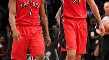 Toronto Raptors guard Kyle Lowry (7) and guard Greivis Vasquez (21) react against the Brooklyn Nets during the second half in game four of the first round of the 2014 NBA Playoffs at Barclays Center. The Raptors defeated the Nets 87-79. (Adam Hunger/USA Today Sports)