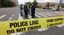 Police tape seals off a downtown Kelowna, B.C., street corner at the scene of a multiple shooting on Aug. 14, 2011. (Chris Stanford/The Canadian Press/Chris Stanford/The Canadian Press)