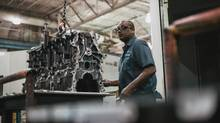 Rusty Stiles operates a gun drill on an assembly line at the Linamar factory in Arden, N.C. (Mike Belleme/The Globe and Mail)
