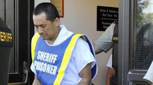Vince Weiguang Li, suspect in the murder of Tim McLean aboard a Greyhound bus in Manitoba, leaves after making a court appearance in Portage la Prairie August 5, 2008. (Fred Greenslade/Reuters/Fred Greenslade/Reuters)