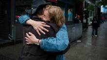 Homeless advocate Judy Graves hugs Downtown Eastside resident Shawn, who she has known for 17 years, after stopping to talk to him on the street on May 28, 2013. (DARRYL DYCK FOR THE GLOBE AND MAIL)