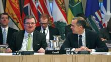 Jim Flaherty, the Finance Minister, and the outgoing Governor of the Bank of Canada, Mark Carney. (CHRIS WATTIE/REUTERS)