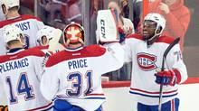 Goalie CareyPrice and defenseman P.K. Subban celebrate their win against the Ottawa Senators (Marc DesRosiers/USA TODAY Sports)