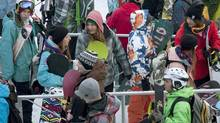 Thousands of skiers and snowboarders wait in line at the base of Whistler gondola on opening day of the ski resort in Whistler, B.C., Friday, Nov. 18, 2011. (Jonathan Hayward/The Canadian Press/Jonathan Hayward/The Canadian Press)