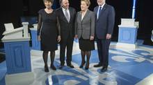 From left, Quebec Solidaire Leader Francoise David, Coalition Avenir du Quebec Leader Francois Legault, Parti Quebecois leader Pauline Marois, and Liberal leader Philippe Couillard pose for a photograph prior to the leaders' debate Thursday, Thursday, March 20, 2014 in Montreal. (Paul Chiasson/THE CANADIAN PRESS)
