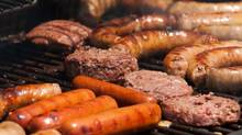 Hot dogs, burgers and sausages at a summer barbecue. (Thinkstock)