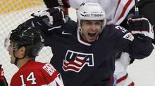 Patrick Dwyer of the U.S. celebrates after scoring next to Canada's Jordan Eberle during their 2012 IIHF ice hockey World Championship game in Helsinki May 5, 2012. (GRIGORY DUKOR/REUTERS/GRIGORY DUKOR/REUTERS)