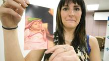Dani Whitehead with a photo of Harper Whitehead. (Tara Grindle)