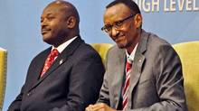 The government of Rwandan President Paul Kagame, right, has been accused of training Burundian rebels with the goal of overthrowing Burundi President Pierre Nkurunziza, left. (STEVE TERRILL/AFP/Getty Images)