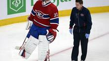 Montreal Canadiens goalie Carey Price (31) stretches his leg after being run into by New York Rangers Chris Kreider during second period in game one of the Eastern Conference final on Saturday May 17, 2014 in Montreal. (Ryan Remiorz/THE CANADIAN PRESS)