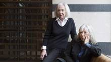 "Sisters Jane, left, and Anna McGarrigle pose for a photograph after talking about their memoir ""Mountain City Girls"" Toronto on Monday, November 9, 2015. (Nathan Denette/THE CANADIAN PRESS)"