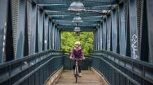 Betty Poon's commute to work takes her over a foot bridge that connects the Moore Park and Rosedale neighbourhoods in Toronto. (Tim Fraser/The Globe and Mail)
